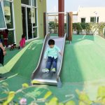 kid on slide